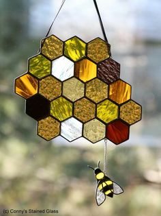 Bee and honeycomb glass.