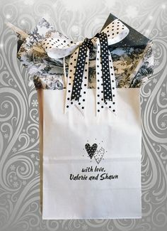 Val and Shawn married at First Baptist Church of San Antonio. Their black and white wedding colors made this combination (1 1/2 inch white with black dot and 5/8 inch black with white dot)so tempting. Presentation is everything! This wedding welcome bag is a traffic-stopper. Check out www.favorsyoukeep.com to see all our original and unique ideas. Questions? In a rush? Call us at 512.323.0600