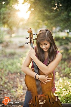 "I think I might take pictures with my cello both at the ""concert hall"" site and the outdoors one :) I love this pose!"