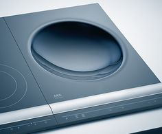 AEG induction wok lets you enjoy one of the oldest ways of cooking food using the most innovative heating technology. The 36 cm induction wok Read Induction Stove, Induction Cookware, Pantry Design, Kitchen Design, Id Design, Home Technology, Kitchen Tools And Gadgets, Tiny House Design, Cool Kitchens
