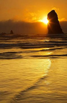 Eye of the Needle | golden sunset, the Needles, Cannon Beach, Oregon by Mike Dawson