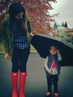 Mom & girl rainy day stroll & red Hunter boots. She will be getting matching ones for Christmas!
