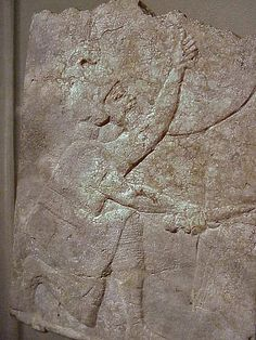 Relief of a Kneeling Soldier from King Ashurbanipal's palace at Nineveh Assyrian 668-627 BCE calcite-alabaster