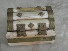 The piece was made in India. There is a brass hinge and latch with brass edging or rails along the lid. The interior of the box is lined with what looks like black colored felt. Brass Hinges, Antique Boxes, Sell Items, Trinket Boxes, Camel, Bones, Decorative Boxes, Felt, Carving