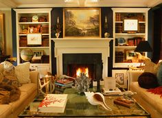 living rooms, fireplac, blue walls, color, bookcas, family rooms, den, live room, white cabinets