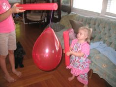 2 pool noodle games - a ball run to make stair play interesting (stair play supports core strength) and batting at a balloon for balance and stability practice. Plus it's just fun!