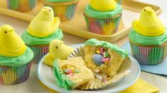 PEEPS Chick Surprise-Inside Cupcakes Easter surprises have never been so sweet! Bake up these festive Easter cupcakes fill with colorful sprinkles and top with a yellow PEEPS chick to surprise someone. Learn to make this recipe with our how-to. Desserts Ostern, Köstliche Desserts, Holiday Desserts, Holiday Recipes, Delicious Desserts, Dessert Recipes, Cupcake Recipes, Yummy Recipes, Gourmet Cupcakes
