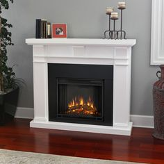 This will be my new fireplace, every home needs a fireplace! Real Flame Porter 50 in. Electric Fireplace in at The Home Depot Gel Fireplace, Fireplace Design, Fireplace Mantels, Fireplace Ideas, Fireplace Seating, White Fireplace, Mantle, White Electric Fireplace, Electric Fireplaces