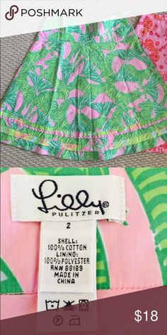 "Lilly Pulitzer cotton fully lined summer skirt Lilly Pulitzer 100% cotton fully lined summer skirts, sz 21 A-line, green pink left zip closure  Waist:14"" Length:23.5"" Good condition with showing of wear(pic#8) Lilly Pulitzer Skirts"