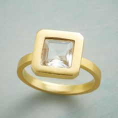 A fetching clarity and shimmer draws the eye to this chic, square white topaz ring.