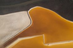 San Francisco Salt Ponds Photo: Jeffrey Goodman Shot this looking out the window of an airplane while flying over San Francisco Bay. These colorful designs are salt evaporation ponds located at the southern tip of San Francisco Bay. The differing colors come from the different types of algae that grow on top!