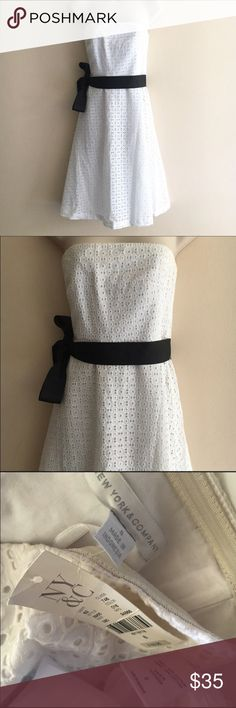 NWT New York & Company white strapless dress sz 8 NWT New York & Company white tube dress Size 8 beautiful white cut work dress. Comes with a black sash to tie on your side or back, zip closure at the back. Comes from a smoke free pet free home. Bundle for greater discounts! New York & Company Dresses Strapless