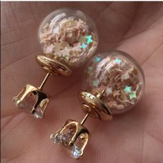 Iridescent Neutral Stars Filled Globe Double Side Rhinestone post goes through pierced earlobe to connect to large globe. Globe is the back of the earring that is worn behind the earlobe. Globe/back may be larger than expected if unaccustomed to double sided earrings. For pierced ears. Earrings do not contain actual candy. Brand new in package. No trades, no holding, no offsite payment. ANY $9 earrings are 2 pairs for $15. *~*PRICES ARE FIRM*~* Jewelry Earrings