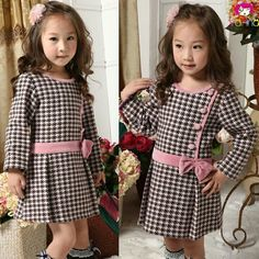 Thicker fabric, large skirt pleats, contrasting button and belt details Dresses Kids Girl, Cute Dresses, Baby Girl Fashion, Fashion Kids, Baby Dress Design, Kids Frocks, Girl Dress Patterns, Baby Outfits, Toddler Dress