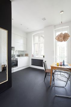 Charming Minimalist Apartment in Poland by halo. architecture with disco mirror tile backsplash.