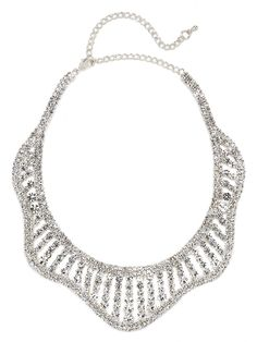 Shine in this singular bib necklace, with scallop detailing and more crystals than you could shake a stick at.