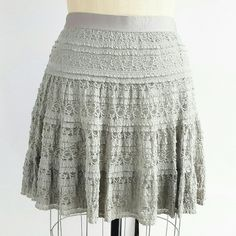 """Max Studio Lace Skirt in grey Max Studio Lace Skirt  in grey - shell 96% nylon 4% spandex with a knit lining of 86 % rayon 14% spandex . Exposed elastic waistband 17.5"""" length and waist is 15"""" flat Max Studio Skirts"""