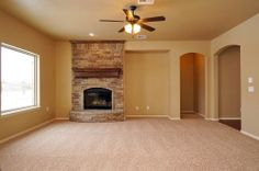 MOVE IN READY new home in Yukon, Oklahoma.  Valdera. Glenbrook floor plan. Living room. Fireplace. 10032 Volare Drive. http://4cornershomes.com/c_movein_details.php?item=15&home=174