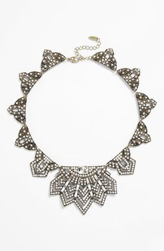 Free shipping and returns on Natasha Couture Art Deco Crystal Bib Necklace at Nordstrom.com. Art Deco-inspired design and intricate detailing make this statement necklace utterly glamorous: a large crystal tops the glittering baguette and round crystal-encrusted centerpiece, while sparkling, geometric-shaped pendants fan out around it.