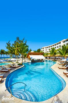 Lounge and relax in style at Sandals Barbados, where the main pool also has a swim up bar - it's Caribbean perfection at it's best.