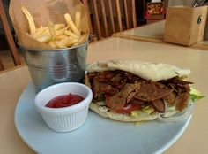 VEGAN DONER KEBAB. Grilled seitan, shredded romaine lettuce, tomatoes, cucumbers, onions, freshly chopped mint and  house-made creamy garlic yogurt sauce in warm pita. Served with fries and ketchup.