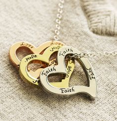 """Good things come in threes, like our spirited triple-heart necklace bearing a sincere message of """"Faith, Hope, Love."""""""