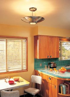 The mid-century modern kitchen stunningly recreated by Rejuvenation Inc. as a setting for its perio. Vintage Kitchen Cabinets, Painting Kitchen Cabinets, Mid Century Decor, Mid Century House, Kitsch, Painting Light Fixtures, Modern Architecture Design, Mid Century Modern Kitchen, 1960s Kitchen