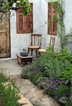 Whitewash walls, wood shutters, lavender, herbs, stone path...... oh yeah