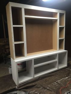 Build your own entertainment center! Free plans and cut list! Build your own entertainment center! Free plans and cut list! Bookshelf Entertainment Center, Entertainment Center Wall Unit, Entertainment Ideas, Easy Woodworking Projects, Diy Projects, Unique Woodworking, Woodworking Plans, Project Ideas, Diy Tv