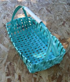 Packing strap basket.  The material is plastic strapping. Woven into a basket shape.