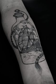 ship in a bottle forearm tattoo black line