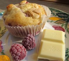Raspberry-white-chocolate-muffins with almond slivers *