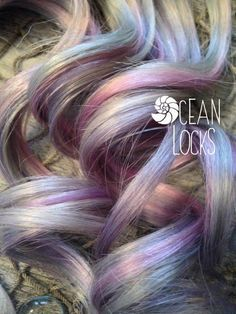 Try out the popular Moonlight hair! This pastel color combo would look great in blonde hair! Buy 2 pieces for a few pops of color , or buy more and spread them throughout your hair! This listing is for 2-8 clip-in pieces, 1.5 wide each, 16 or 20 long. Message me if you need a different length:) These are Pale pink, lavender, & silver highlighted extensions Origin: Brazilian Grade: Remy Human Hair Type: Straight Color: Multi Method: Clip-In Double Drawn & Quadruple Weft Double drawn...