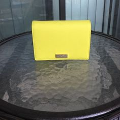 Kate Spade Cara WAllet -Color: bright Cubanelle (neon yellow/green) -Condition: good, used two times   ❌No trades!❌ Smoke free.  Best offer. kate spade Bags Wallets