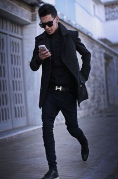 Pair a black pea coat with black slim jeans for a work-approved look. Show your sartorial prowess with a pair of black leather double monks.   Shop this look on Lookastic: https://lookastic.com/men/looks/pea-coat-long-sleeve-shirt-skinny-jeans/17082   — Black Long Sleeve Shirt  — Black Pea Coat  — Black Leather Belt  — Black Skinny Jeans  — Black Leather Double Monks