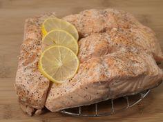 A recipe for Pressure Cooker Salmon Steaks made with onion, salmon steaks, white wine, salt, black pepper, lemon
