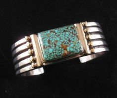 X Large Navajo Orville Tsinnie Kingman Turquoise Silver Bracelet w 14kt Gold | eBay  Check this one out..It doesn't get much better than this!