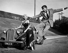 by Frank Worth These were taken during the production of How To Marry A Millionaire. Frank was known for his rarely seen candid photos of actors, such as this photo of Sammy Davis Jr. jumping for joy in front of Marilyn. Sammy Davis Jr, Marilyn Monroe Photos, Marylin Monroe, Classic Hollywood, Old Hollywood, Becoming An Actress, Roadster, Jumping For Joy, Norma Jeane