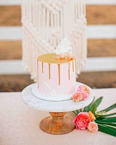 A Boho California Wedding with a Tropical Twist | Martha Stewart Weddings - The main cake was a Funfetti confection (a favorite of the bride's growing up). The other two were chocolate and brown sugar cinnamon crumb. Here, the crumb cake, was topped with dripping edible gold, hand-cut modeling chocolate in the shape of banana leaves, white rock candy, and mini strawberry macarons.