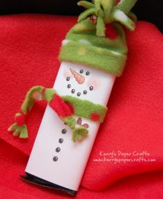 Snowman Chocolate Bar Wrapper: Made these last Christmas for neighbor gifts and for grandchildren to give to teachers. So easy and so fun to make. Assembly line works great! I got my instructions from Kerry's Paper Crafts, which included a print out for the wrapper!