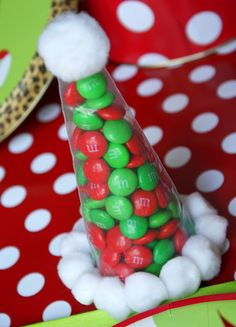 Sanata hats~ fill a disposable icing bag with a scoop of red and green candies. Secure the bottom with a twist tie, and cut off the excess bag. Hot glue small pom-poms around the base of the hat and a larger one to the top.