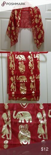 Scarf This is a beautifully designed scarf.  It has a red background with metall...  Scarf This is a beautifully designed scarf.  It has a red background with metall...  Scarf This is a beautifully designed scarf.  It has a red background with metallic gold designs.  The designs look like ancient primitive drawings.  It measures 60