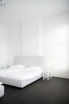 Simple black and white bedroom. Designer unknown.