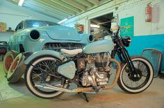 Royal Enfield 500 Bullet bobber motorcycle in powder blue - white leather seat - and white wall tires