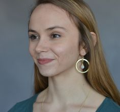 Our Lakshmi Loop Earrings are handmade by our partner female artisans from India.