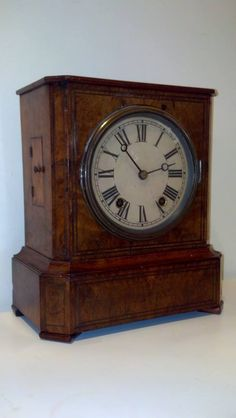 A burled walnut German clock dating to about 1870 that stands 11 inches high. I will be overhauling this soon! Great wood, not too big, and a nice movement.