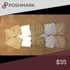Men's shorts lot 5 pairs Men's shorts.  2 pair flat front, 3 pairs of cargo.  4 are size 32 waist.  The top cargo pair are size 33.  All in good condition.  Smoke free home. All reasonable offers will be considered. Shorts Cargo
