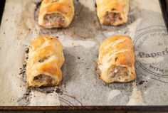 Homemade sausage rolls. Light and flaky pastry gives way to a delicious meaty pork filling. British comfort food & a dietary staple.