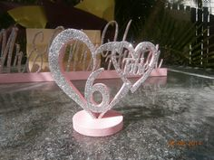 silver glitter and baby pink table numbers