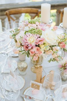 Elegant wedding ideas: soft pink and white floral centerpieces with bits of gold